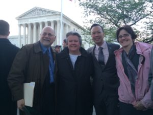 Standing in front of U.S. Supreme Court