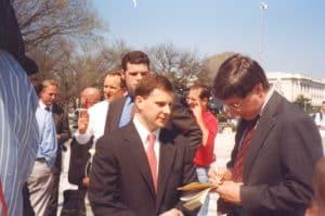 Ben Klein talking to reporter