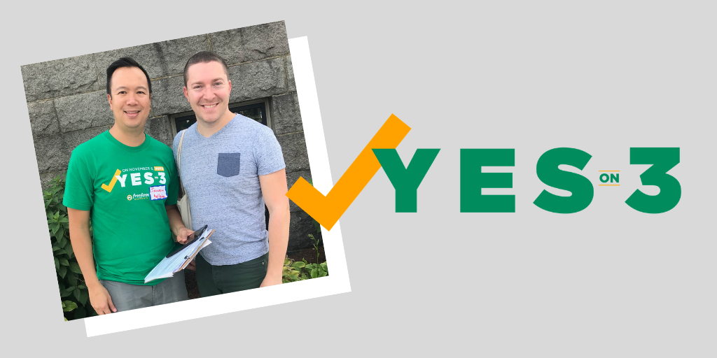 Yes on 3 photo with Executive Director and Events Manager smiling during canvassing event