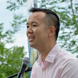 GLAD Executive Director Janson Wu speaking, outdoors