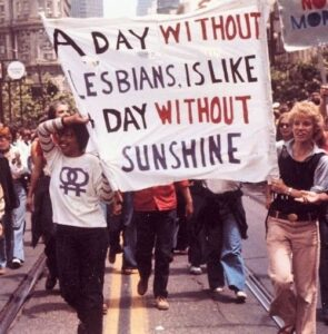 """Poster: """"A Day Without Lesbians Is Like A Day Without Sunshine"""""""